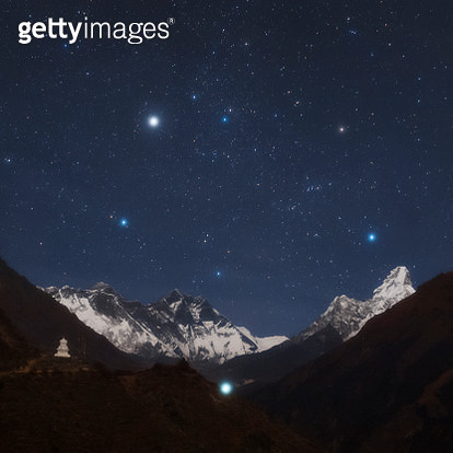 'Constellation Auriga with bright star Capella above Mount Everest, Lhotse, Ama Dablam, and a stupa on the Everest base camp.' - gettyimageskorea