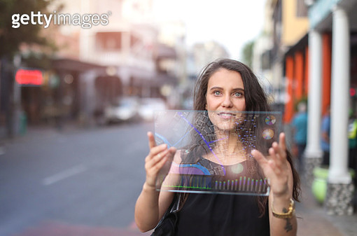 a Young woman looking at a digital map. - gettyimageskorea