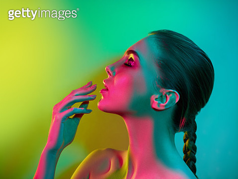 High Fashion model woman in colorful bright lights posing in studio, portrait of beautiful sexy girl with trendy make-up and manicure. Art design, colorful make up. Over colourful vivid background. - gettyimageskorea