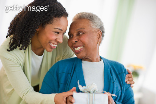 Daughter giving mother birthday gift - gettyimageskorea