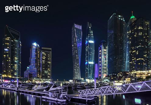 Majestic Dubai Marina skyscrapers illuminated at night in Dubai, UAE - gettyimageskorea