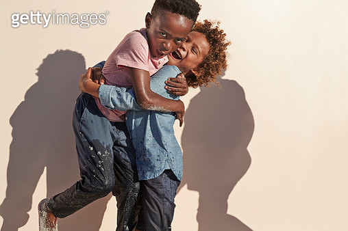 Cute kids playing and posing for the camera, shot on studio background by the beach - gettyimageskorea