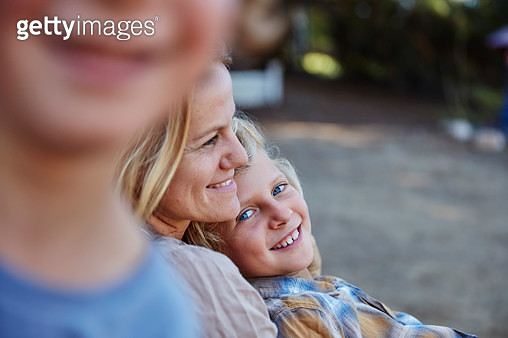 Happy mother with two sons outdoors - gettyimageskorea