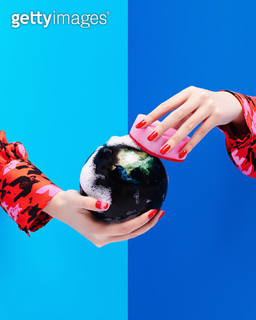 Two hands holding a globe and cleaning with a sponge and soap. - gettyimageskorea