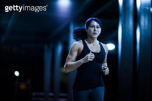 woman running at nighttime - gettyimageskorea