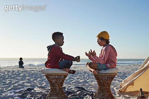 Kids enjoying the beach at sunset - gettyimageskorea