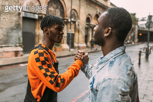 Generation Z - African ethnicity youth handshake - United Kingdom - gettyimageskorea