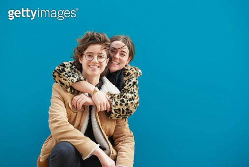 Female couple in an embrace. - gettyimageskorea