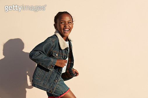 Portrait of cute girl laughing, on studio background - gettyimageskorea