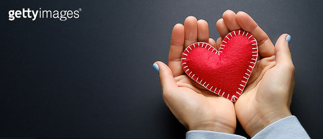 The Girl Is Holding A Red Handmade Heart On A Black Background. Banner. - gettyimageskorea