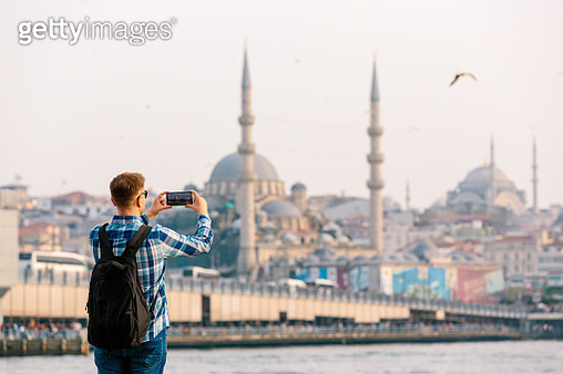 Tourist photographing Istanbul skyline with smart phone, rear view - gettyimageskorea