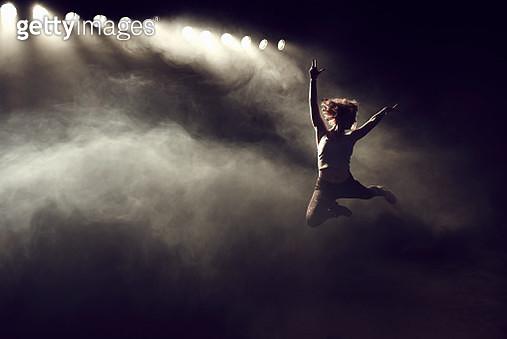 Portrait of woman jumping - gettyimageskorea