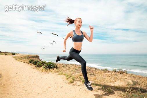 Running on a beach - gettyimageskorea