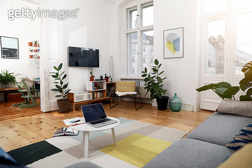 Laptop on a coffee table in a modernly furnished flat - gettyimageskorea