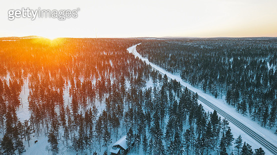 Scenic aerial view of beautiful sunrise over forest and road in winter, Lapland, Finland - gettyimageskorea