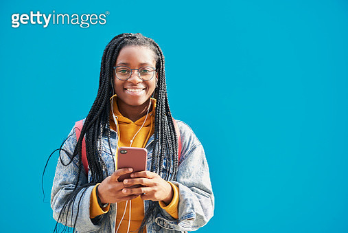Young woman holding smartphone. - gettyimageskorea