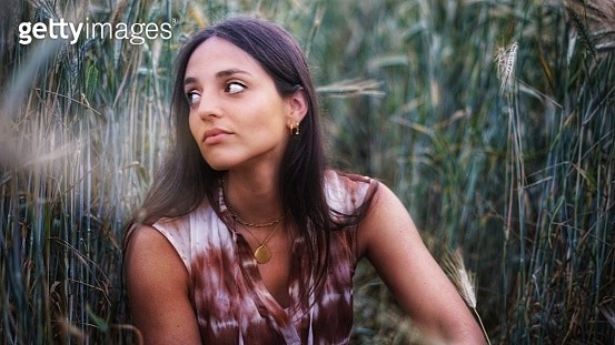 Portrait Of A Beautiful Young Woman Looking Away - gettyimageskorea
