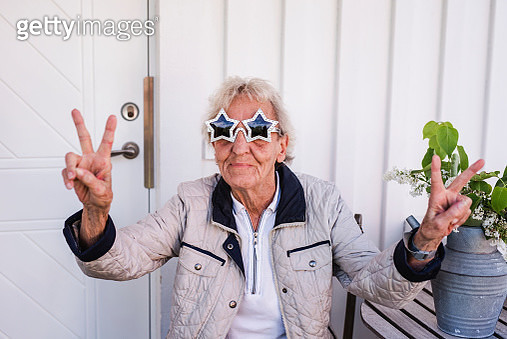 Woman wearing star-shaped sunglasses - gettyimageskorea