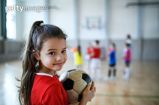 Small children doing sport with instructor. - gettyimageskorea