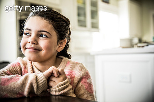 Portrait of girl (7yrs) smiling, indoors - gettyimageskorea