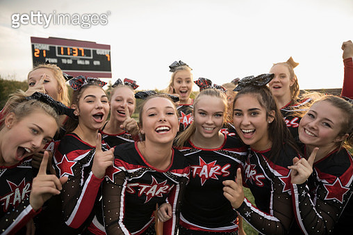 Portrait enthusiastic teenage girl high school cheerleading team gesturing, celebrating - gettyimageskorea