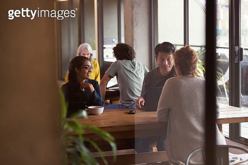 People having informal meeting in co-working space - gettyimageskorea