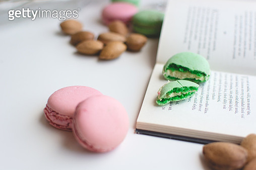 Close-Up Of Macaroons And Book On Table - gettyimageskorea