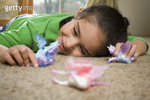 Close-up of a girl playing with toys - gettyimageskorea