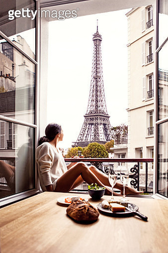 Woman having breakfast in hotel in Paris. The image is a composition. - gettyimageskorea