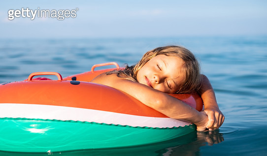 Beauty sleepy girl floating on water at the vacation - gettyimageskorea