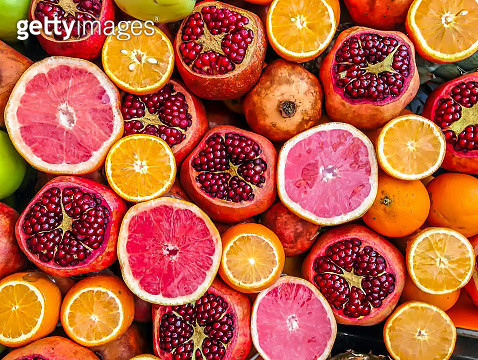 Mixed fruits of oranges and Pomegranates. - gettyimageskorea
