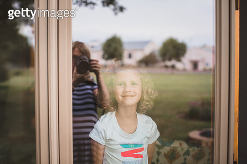 Little Girl Looks Through a window at a photographer - gettyimageskorea