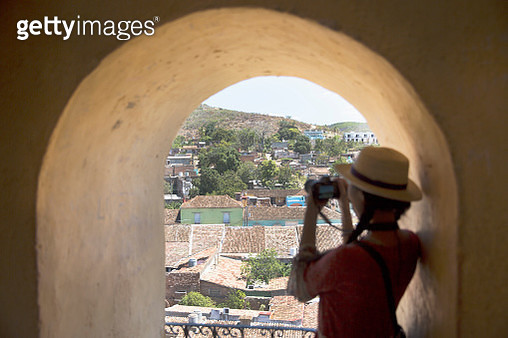 Asian tourist taking photo of rooftops in Trinidad - gettyimageskorea