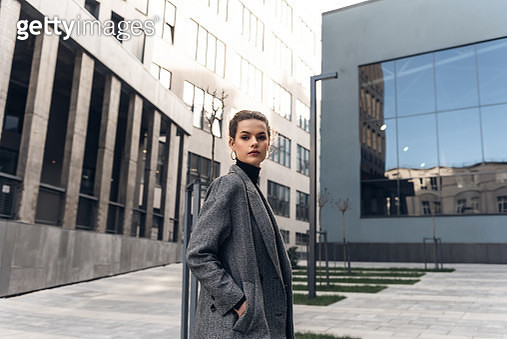 Fashion editorial style pictures of a beautiful girl exploring the raw spaces of a city - gettyimageskorea