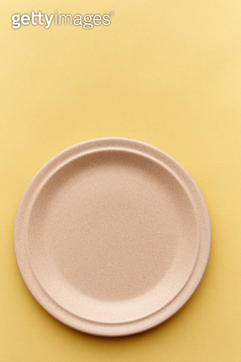 Directly Above Shot Of Plate On Yellow Background - gettyimageskorea