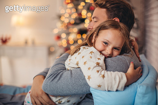 Father and his cute daughter in front of christmas three. - gettyimageskorea