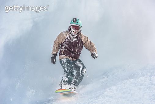 Snowboarder in powder snow - gettyimageskorea