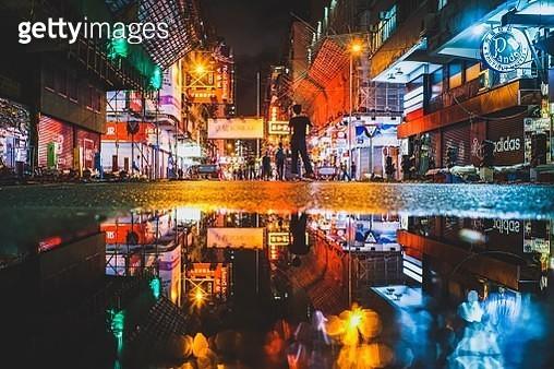 People On Illuminated Street At Night - gettyimageskorea