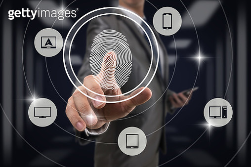 Businessman Fingerprint scan by pressing for unlock all Information technology device over blurred data center server room background, Business Technology sceurity Concept. - gettyimageskorea
