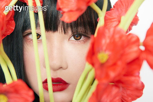 beautiful woman with flowers - gettyimageskorea