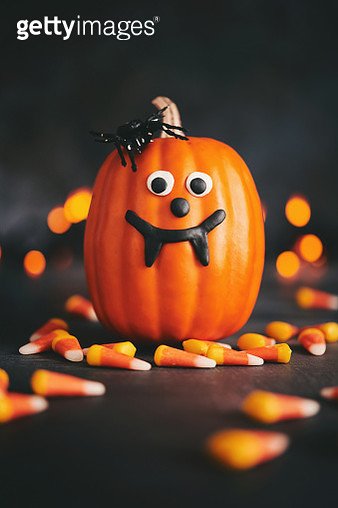 Cute pumpkin character with spider and handmade fangs - gettyimageskorea