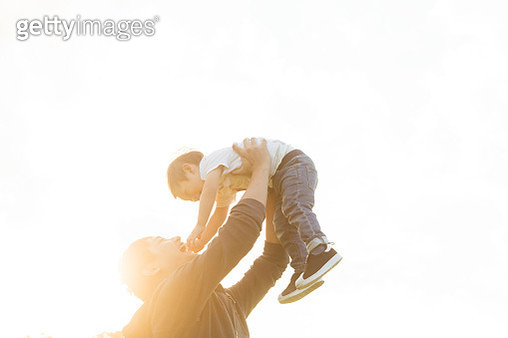 Father and son playing together. - gettyimageskorea