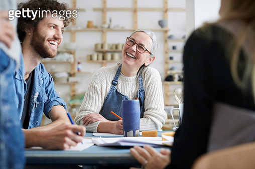 Smiling male and female students learning drawing in art class - gettyimageskorea