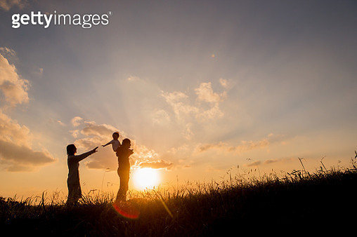 Father who puts his son on his shoulders, mother walking together. - gettyimageskorea