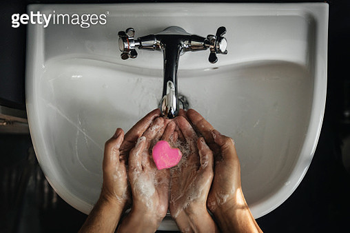 Hands holding heart shaped soap - gettyimageskorea