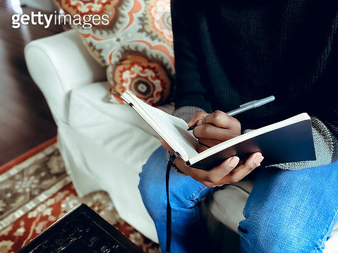 Woman Writes in Journal - gettyimageskorea