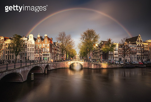 Amsterdam canals with rainbow - gettyimageskorea