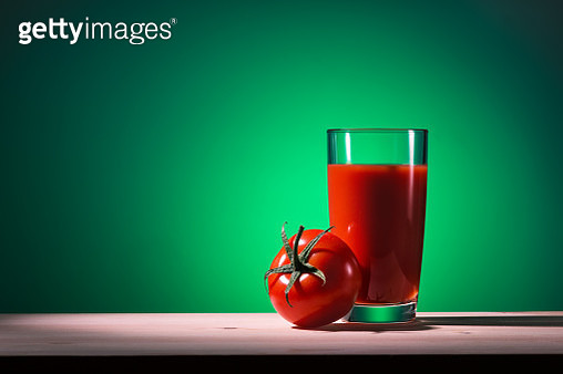 Glass Of Tomato Juice And Tomato On Wooden Table - gettyimageskorea