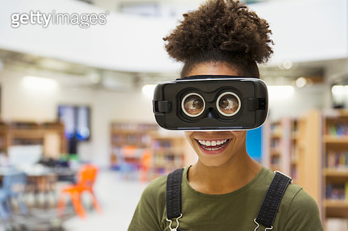 Portrait playful junior high girl student wearing virtual reality glasses - gettyimageskorea