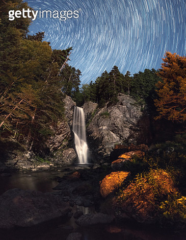 Star Trails and Waterfalls - gettyimageskorea
